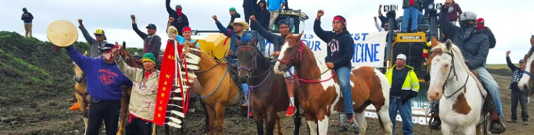 water-protectors-on-horses